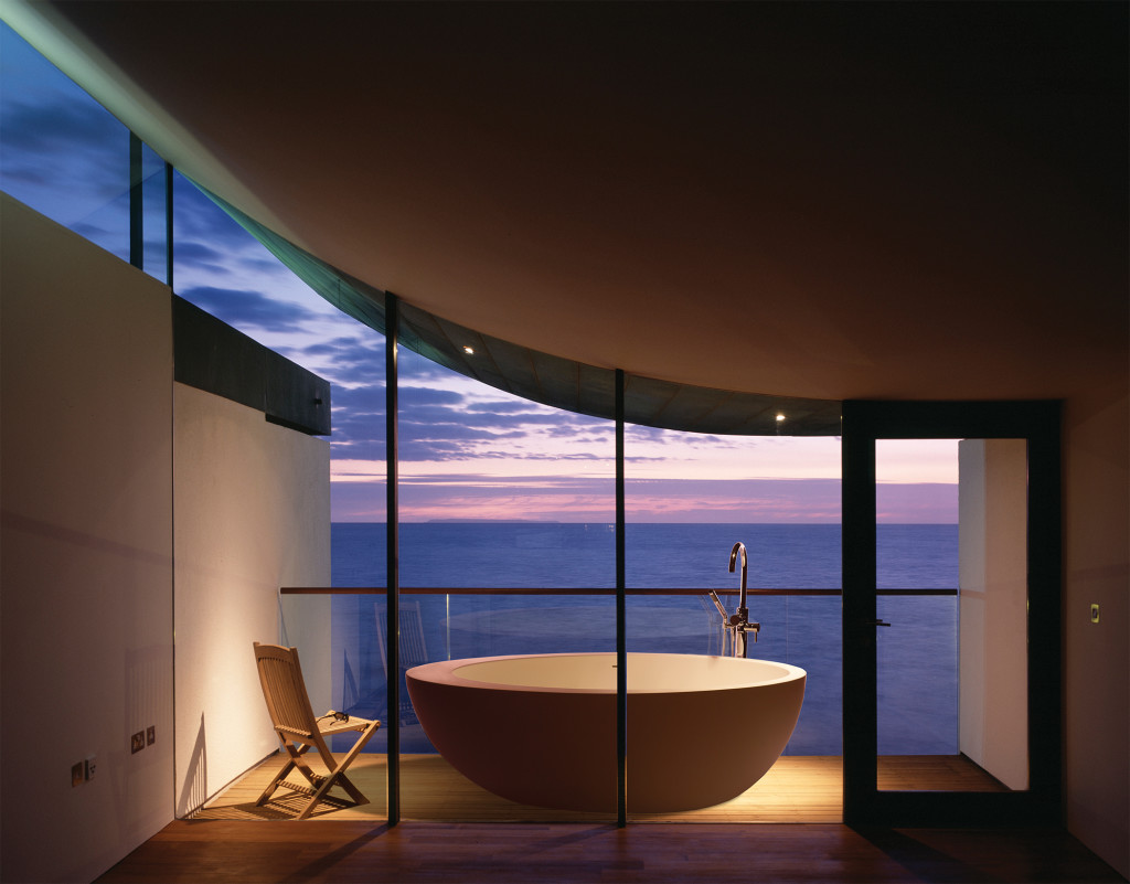 NAUTILUS, GOLF LINKS ROAD, WESTWARD HO!, DEVON, UK, GUY GREENFIELD ARCHITECTS, INTERIOR, VIEW TOWARDS BALCONY AT TWILIGHT